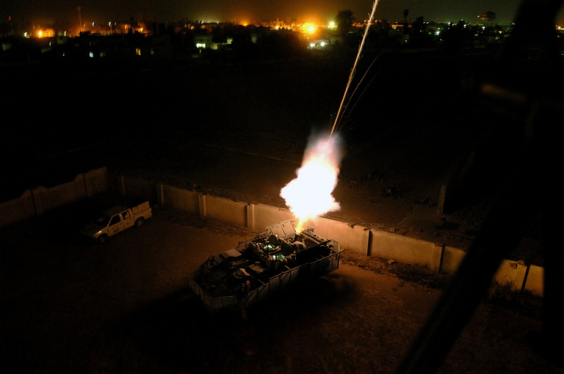 US Army (USA) Soldiers fire illumination flares from a 120mm mortar cannon on a mortar carrier Stryker in Mosul, Iraq (IRQ) during Operation IRAQI FREEDOM. The USA Soldiers are from Headquarters and Headquarters Squadron (HHS), 1st Battalion, 17th Infantry Regiment (1/17th Infantry), 172nd Stryker Brigade Combat Team (SBCT), Ft. Wainwright, Alaska (AK).
