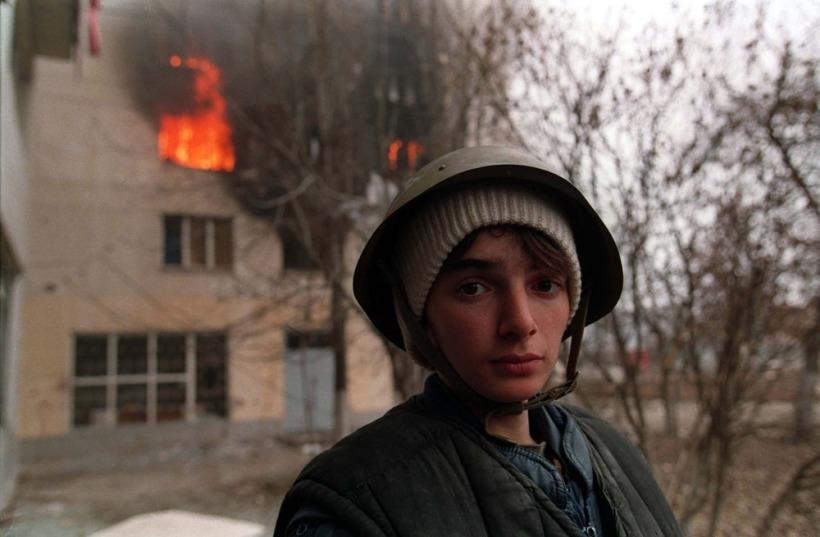 evstafiev-chechnya-boy-house-burns